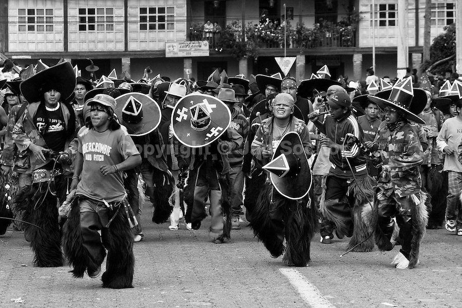 Indians dance furiously during the Inti Raymi (San Juan) festivities in Cotacachi, Ecuador, 29 June 2010. 'La toma de la Plaza' (Taking of the square) is an ancient ritual kept by Andean indigenous communities. From the early morning of the feast day, various groups of San Juan dancers from remote mountain villages dance in a slow trot towards the main square of Cotacachi. Reaching the plaza, Indians start to dance around. They pound in synchronized dance rhythm, shout loudly, whistle and wave whips, showing the strength and aggression. Dancers from either the upper communities (El Topo) or the lower communities (La Calera), joined in respective coalitions, seek to conquer and dominate the square and do not let their rivals enter. If not moderated by the police in time, the high tension between groups always ends up in violent clashes.