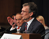 Washington, D.C. - January 8, 2009 -- Former United States Senator Tom Daschle (Democrat of South Dakota) testifies before the United States Senate Committee on Health, Labor, Education, and Pensions on his nomination to be Secretary of Health and Human Services in Washington, D.C. on Thursday, January 8, 2009.  Former United States Senator Bob Dole (Republican of Kansas) looks on from left..Credit: Ron Sachs / CNP