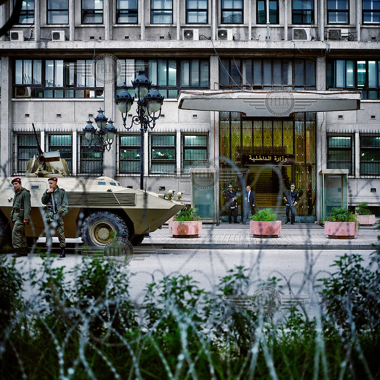 Barbed wire, soldiers and an armoured personel carrier at the entrance to the Ministry of Interior on Bourguiba Avenue.