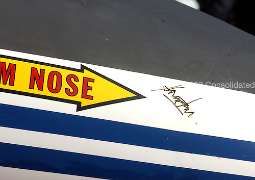 "Harrison Ford's autograph is on the front nose of the XV-15 tilt rotor aircraft.  Ford flew as a ""guest pilot on the aircraft.  It took its place in what could be called ""aviation's hall of fame,"" when NASA and the U.S. Army transferred the vehicle to the National Air and Space Museum's new Steven F. Udvar-Hazy Center near Washington Dulles International Airport in Herndon, Virginia on September 16, 2003.  Tilt rotors are a unique type of aircraft that possess the take-off, hover and landing capabilities of a conventional helicopter with the range and speed of a turboprop aircraft.  Tilt rotor flight research began in the 1950s with the Bell XV-3 convertiplane.  NASA's Ames Research Center, Moffett Field, Calif., in partnership with the U.S. Army, developed design specifications for a new aircraft to demonstrate the viability of the tilt rotor concept.  After extensive ground, wind tunnel and simulator tests at Ames, the first of two XV-15s, built by Bell Helicopter Textron, took its maiden flight on May 3, 1977.  The success of the XV-15 has led to the development of the V-22 Osprey and the world's first civil tilt rotor, the nine-passenger Bell Agusta 609, now under development and scheduled for deliveries in 2007.  The National Air and Space Museum, comprised of the Udvar-Hazy Center, which is scheduled to open to the public on December 15, 2003, and the museum's building on the National Mall, .will be the largest air-and-space-museum complex in the world. .Credit: Ron Sachs / CNP"