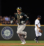 Oakland Athletics Josh Donaldson rounds the bases after hitting a solo home run to left field in the sixth inning Seattle Mariners in the inning September 13, 2014 at Safeco Field in Seattle.   UPI/Jim Bryant