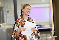 NWA Democrat-Gazette/CHARLIE KAIJO Teacher Brianna Palmer reacts after receiving a grant award, Monday, May 13, 2019 at Heritage High School in Rogers.<br /><br />Members of the Rogers Public Education Foundation awarded over $172,000 in grants to teachers during surprise visits Monday. <br /><br />These grants will help fund many classroom needs that are beyond the schoolsÕ budgets including additional iPads, Chromebooks, video equipment, math tools, integrated movement opportunities, as well as supplies for literacy activities, science, art, physical education and music.