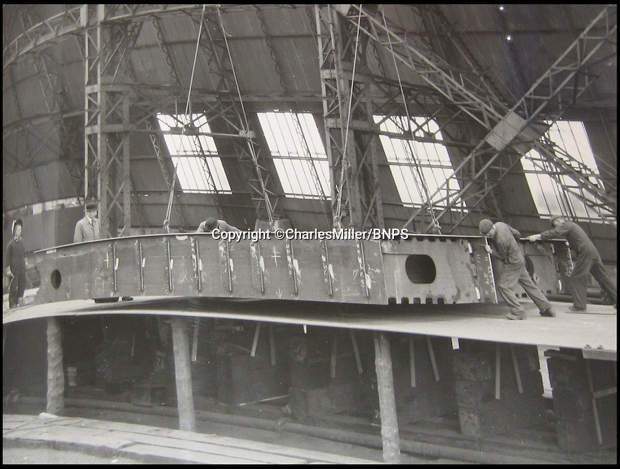 BNPS.co.uk (01202 558833)<br /> Pic: CharlesMiller/BNPS<br /> <br /> ***Must use full byline***<br /> <br /> First keel plate being laid by workers.<br /> <br /> Rare photographs showing the complete construction of the much-loved Royal yacht Britannia have surfaced 60 years later.<br /> <br /> The image archive was recorded by shipbuilders John Brown & Co during the 10 months it took to build the 412ft long vessel for Queen Elizabeth II.<br /> <br /> The 70 black and white photos document virtually every stage of the project, from the laying of the keel in June 1952 to the furnishing of state dining room in April 1953.<br /> <br /> They show cloth-capped, blue collar engineers hard at work while management in smart suits and bowler hats carefully inspect the build.<br /> <br /> Some of the shots of the yacht in dry dock show it covered in scaffolding and highlight the two enormous propellers at the stern.