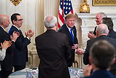 United States President Donald J. Trump shakes hands with governors after addressing the 2019 White House Business Session at the White House in Washington, D.C. on February 25, 2019. Trump discusses the group on infrastructure, the opioid epidemic, border security and China trade policy.  Looking on from left is US Secretary of the Treasury Steven T. Mnunchin.<br /> Credit: Kevin Dietsch / Pool via CNP