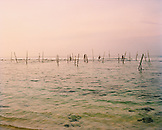 SRI LANKA, Asia, view of stick fishing in Indian Ocean