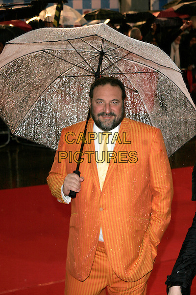 """JOEL SILVER .Arriving at the """"Speed Racer"""" UK film premiere, Empire Leicester Square, London, England..April 28th 2008.half length orange pinstripe suit umbrella hand in pocket beard facial hair .CAP/AH.©Adam Houghton/Capital Pictures."""