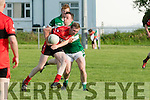 Going Through<br /> --------------------<br /> Jason Wrenn, Tarbert is held up by Damian Clifford, Listry as he tries to advance when the teams met in Lisrty GAA grounds last Saturday evening.