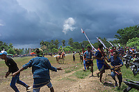 March 26, 2016 - Ratenggaro (Indonesia). After a couple of hours of fighting, members of the two teams started throwing stones at each other, resulting in police shooting tear gas to prevent further violence. Many Pasola festivals ended violently in the past, and nowadays police and army are deployed to prevent clashes. © Thomas Cristofoletti / Ruom