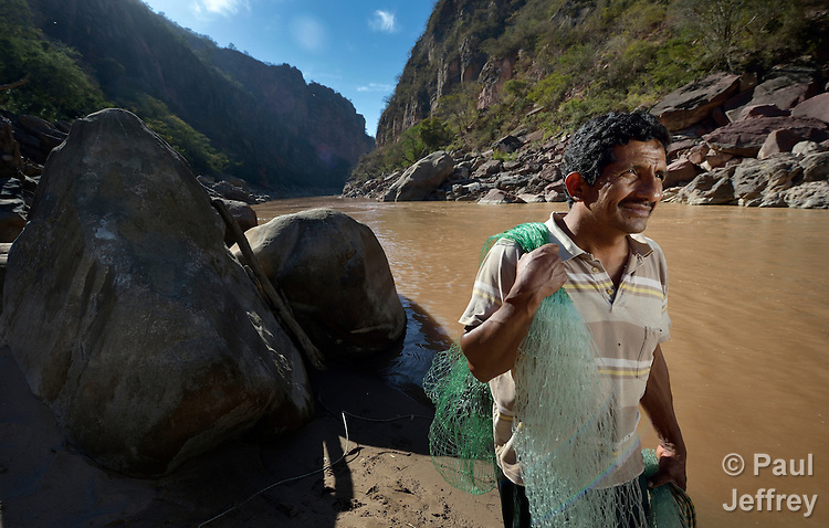 Tomas Rivero fishes for a living on the Pilcomayo River outside of Villamontes, Bolivia. He is a leader of the Union of Pilcomayo River Fishers, and an advocate for cleaning up the river, which has been plagued by contamination from upstream mining and road construction. This portion of the river is inside the protected Aguaragüe National Park and Integrated Management Natural Area.