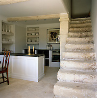 A 19th century French shop counter has been converted into an island in the kitchen