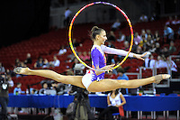 Viktoria Rigo of Hungary split leaps with hoop at 2009 Budapest World Cup on March 7, 2009 at Budapest, Hungary.  Photo by Tom Theobald.