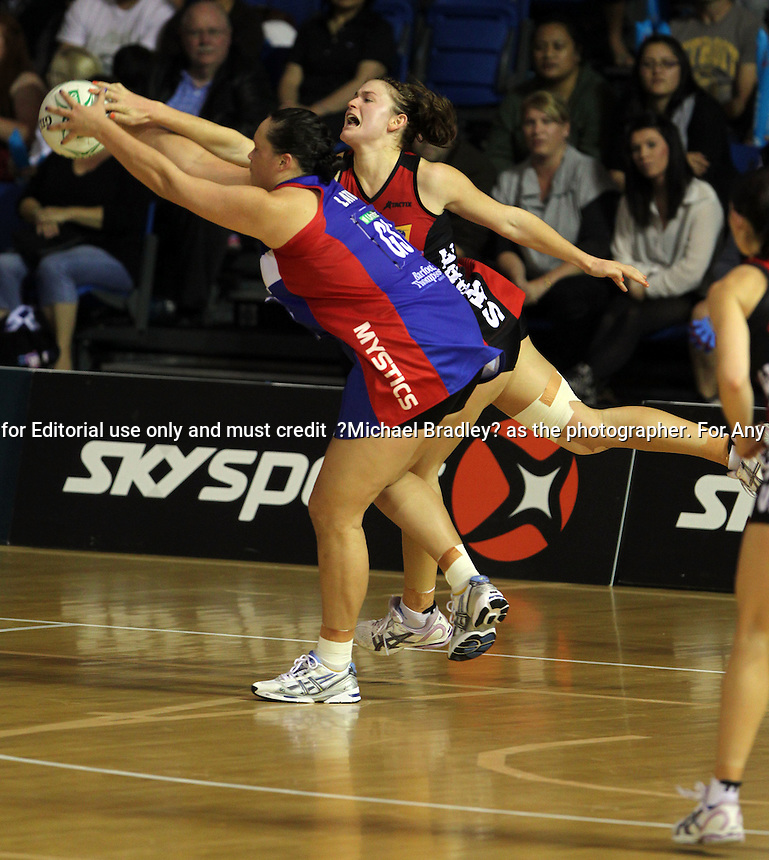 24.04.11 Mystic's Catherine Latu in action during the Round 11 ANZ Championships netball match between the Mystics and Tactix played at the Trusts Stadium in Auckland. Mandatory Credit ©MBPHOTO/Michael Bradley.