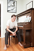 August 11, 2011. Durham, NC..Architect Tom Merrigan, photographed at his home in Durham, has raised money to built a trailer with a piano on it that he plans to set up in various locations around the city to bring music onto the downtown streets.