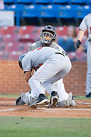 Catcher Francisco Hernandez (16) holds his ground as he is run over by Tim Torres (33) of the Salem Avalanche at Ernie Shore Field in Winston-Salem, NC, Thursday July 27, 2008. (Photo by Brian Westerholt / Four Seam Images)