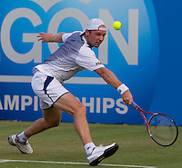 Rainer Schuettler (GER) against Dodi Dela (ISR) in the quarter finals of the men's singles. Rainer Schuettler beat Dodi Sela 7-5 6-4..Tennis - ATP World Tour - AEGON Championships - Queen's Club - London - Day 5 - Fri 11 Jun 2010..© AMN Images - Level 1, Barry House, 20-22 Worple Road, London, SW19 4DH.Tel - +44 (0) 208 947 0100.email - mfrey@advantagemedianet.com. www.photoshelter.com/c/amnimages.