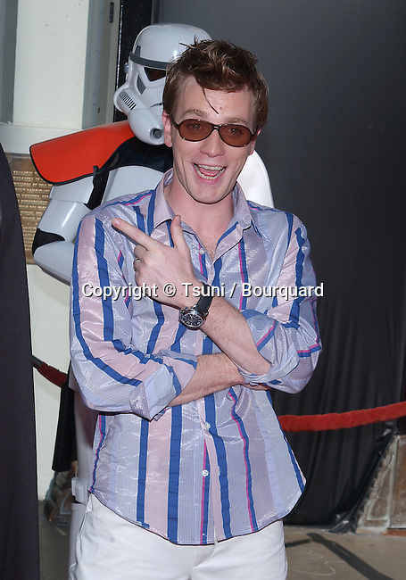"Ewan McGregor posing  at the Los Angeles premiere of "" Star Wars: Episode II Attack of the Clones "" at the Chinese Theatre. May 12, 2002.           -            McGregorEwan01.jpg"
