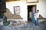 Arelis de Leon, 37, stands outside of her house in San Marcos damaged after a 7.4 earthquake struck Guatemala on Nov. 7.