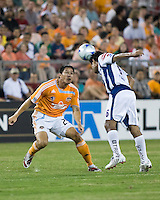 Pachuca FC midfielder Jaime Correa (6) heads the ball away from Houston Dynamo forward Brian Ching (25).  Houston Dynamo defeated Pachuca FC 2-0 in the semifinals of the Superliga 2008 tournament at Robertson Stadium in Houston, TX on July 29, 2008.