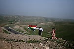 "Kurdish children play in the green hills surrounding the Iraqi city of Kirkuk, hotly contested between Iraqs Arab and Kurdish populations. From ""Yesterday's War, Today's Iraq,"" an ongoing series documenting Iraq and Iraqis as US forces withdraw from the country and media interest wanes. ."