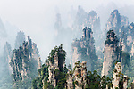 Mountain spires rising from fog at Zhangjiajie National Forest Park, Zhangjiajie, Hunan, China Image © MaximImages, License at https://www.maximimages.com