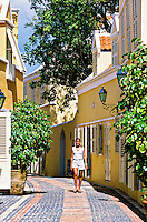 Woman walking through the Hotel Kura Hulanda, Willemstad, Curacao, Netherlands Antilles