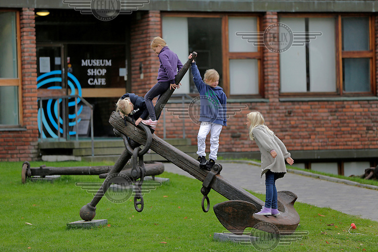 Children play on an anchor outside the Norwegian Maritime Museum.