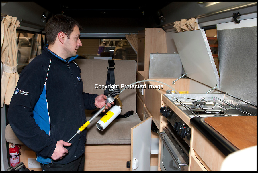 BNPS.co.uk (01202 558833)<br /> Pic: LauraJones/BNPS<br /> <br /> Supervisor Stuart Cox pressure testing the gas system.<br /> <br /> The last ever delivery of brand new Volkswagen campervans has arrived in Britain marking the end of an era for the iconic 'hippy bus'.<br /> <br /> Ninety nine of the final batch of vans rolled off the production line and onto a container ship bound for British shores after manufacture ceased for good in Brazil in December.<br /> <br /> And though the consignment has only just arrived, almost all of the vans have already been snapped up by eager buyers happy to fork out the &pound;35,000 starting price.<br /> <br /> They are the last brand new campers in all of Europe.