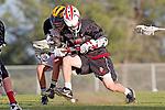 Palos Verdes, CA 03/30/10 - unidentified Peninsula player and unidentified Palos Verdes player in action during the Palos Verdes-Peninsula JV Boys Lacrosse game.