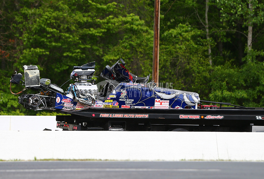 May 5, 2017; Commerce, GA, USA; The car of NHRA super comp driver Jimmy Stahl is towed back to the pits on a flatbed tow truck after crashing during qualifying for the Southern Nationals at Atlanta Dragway. Stahl was alert and transported to a local hospital for observation. Mandatory Credit: Mark J. Rebilas-USA TODAY Sports