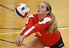 Riley Leimbach #18 of Sacred Heart Academy makes a dig during the third set of a CHSAA varsity girls volleyball match against host St. John the Baptist High School in West Islip on Thursday, Oct. 12, 2017. Sacred Heart won the match 3-0.