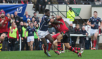 Fautua Otto of Jersey tackles Matt Williams of London Scottish during the Greene King IPA Championship match between London Scottish Football Club and Jersey at Richmond Athletic Ground, Richmond, United Kingdom on 7 November 2015. Photo by Andy Rowland.