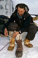 J Garnie Changes Mukluks to Boots Grayling 99 Iditarod AK