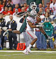 This interference call against Ohio State Buckeyes cornerback Doran Grant (12) on a pass meant of Michigan State Spartans wide receiver Tony Lippett (14)helped set up a Spartan score in the third quarter )at Lucas Oil Stadium in Indianapolis, Ohio on December 7, 2013.  (Chris Russell/Dispatch Photo)