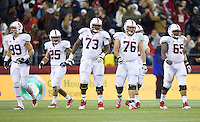 SEATTLE, WA - September 28, 2013: From left, Stanford players wide receiver Devon Cajuste, running back Tyler Gaffney, offensive tackle Cameron Fleming, guard Kevin Danser and center Khalil Wilkes walk to the line of scrimmage during play against Washington State at CenturyLink Field. Stanford won 55-17