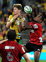Jordie Barrett and Manasa Mataele compete for a high ball during the Super Rugby match between the Hurricanes and Crusaders at Westpac Stadium in Wellington, New Zealand on Saturday, 10 March 2018. Photo: Dave Lintott / lintottphoto.co.nz
