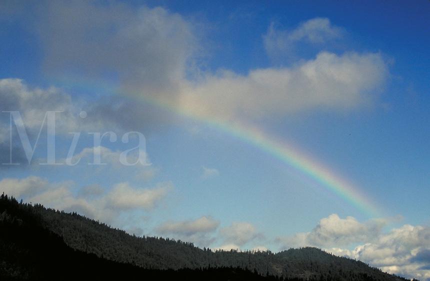 Rainbow over mountains. Oregon USA Josephine County.