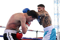 Graham Tirrell (white/blue shorts) defeats Scott Hillman during at Boxing Show at Stevenage Football Club on 18th May 2019