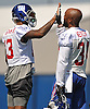Odell Beckham, Jr. #13, New York Giants wide receiver, left, high fives running back Shane Vereen #34 during practice at Quest Diagnostics Training Center in East Rutherford, NJ on Monday, Aug. 29, 2016.