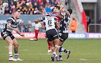 Picture by Allan McKenzie/SWpix.com - 30/03/2018 - Rugby League - Betfred Super League - Hull KR v Hull FC - KC Lightstream Stadium, Hull, England - Salford's Justin carney is upended by Hull FC's Albert Kelly and Mickey Paea.