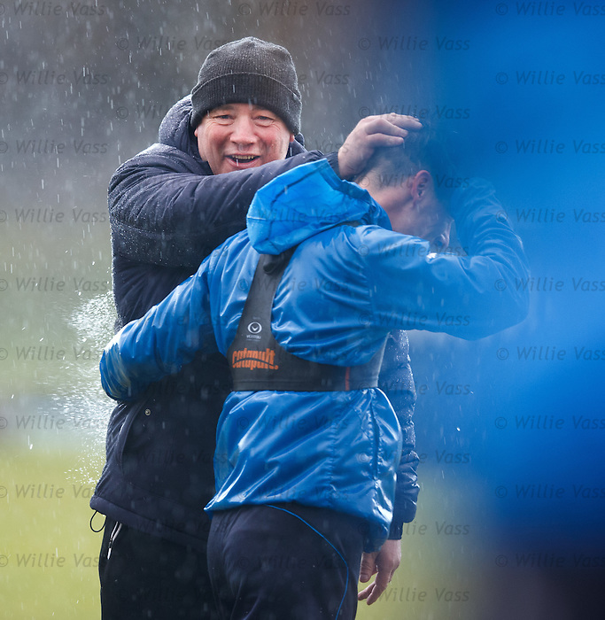 A sodden Ally McCoist as the heavens open at Murray Park