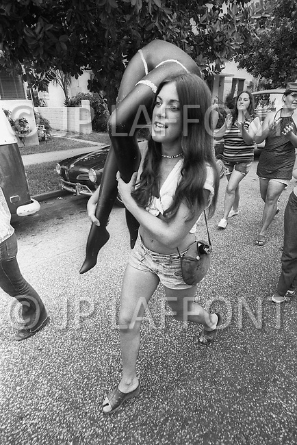 Miami, FL. August 23rd 1972. <br /> Outside of the 1972 30th Republican Convention, during President Richard Nixon's reelection campaign, demonstrators wearing costumes and makeup perform scenes of death and suffering in opposition to the Vietnam War. Several thousand Women's Lib protesters led by Jane Fonda, having just returned from her North Vietnam tour, and the Vietnam Veterans also protested. No clashes with police were reported. Protest against women as sexual symbol.