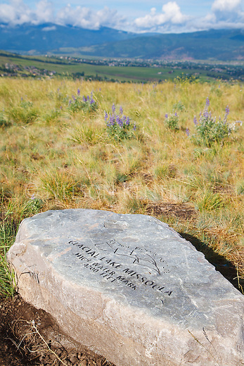 a rock engraved with glacial lake missoula high point information on mount sentinel above missoula, montana
