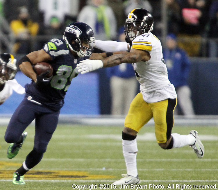 Seattle Seahawks wide receiver Doug Baldwin (89) stiff arms Pittsburgh cornerback Ross Cockrell (31) at CenturyLink Field in Seattle, Washington on November 29, 2015.  Baldwin ran for an 80-yard touchdown in the Seahawks 39-30 win over the Steelers.      ©2015. Jim Bryant Photo. All Rights Reserved.