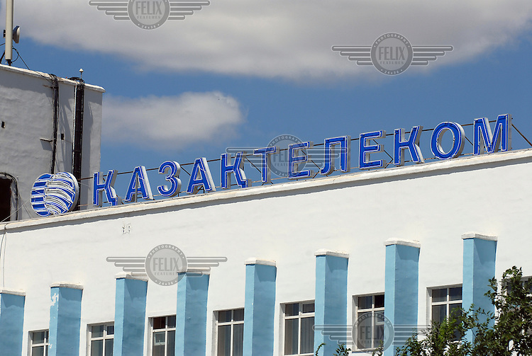 Logo for the Kazakh Telecom company atop its office in Atyrau.