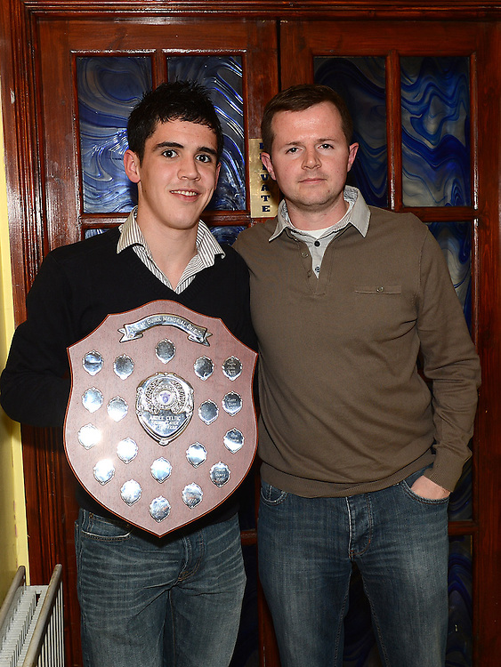 First team manager Conrad Clinton presents the John mcGuirk plaque for young player of the year to Aaron Knowles at the Ardee Celtic awards night in Butterly's Bar. Photo:Colin Bell/pressphotos.ie