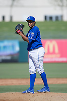 Kansas City Royals pitcher Ofreidy Gomez (56) prepares to deliver a pitch to the plate during an Instructional League game against the Cincinnati Reds on October 2, 2017 at Surprise Stadium in Surprise, Arizona. (Zachary Lucy/Four Seam Images)