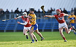 Ian Galvin of Clare in action against Eoghan Finn and Lorcan Mc Loughlin of Cork during their Munster Hurling League game at Cusack Park. Photograph by John Kelly.