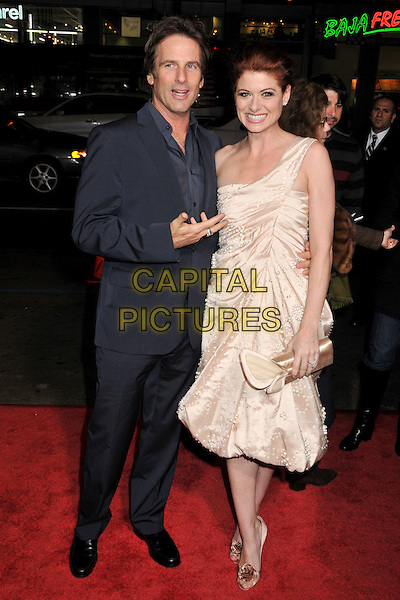 "HART BOCHNER & DEBRA MESSING.""Nothing Like the Holidays"" Los Angeles Premiere at Grauman's Chinese Theatre, Hollywood, California, USA..December 3rd, 2008.full length gold one shoulder diamond  beaded beads blue suit hand clutch bag silk satin cream peach beige .CAP/ADM/BP.©Byron Purvis/AdMedia/Capital Pictures."