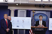 Brad Smith, deputy administrator at the Center for Medicare & Medicaid Innovation, speaks during a news conference at the White House in Washington D.C., U.S. on Monday, April 20, 2020. At left is US President Donald J. Trump and Admiral Brett Giroir, US Assistant Secretary for Health.<br /> Credit: Tasos Katopodis / Pool via CNP