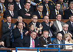 Ex-Rangers manager Alex McLeish watching from the main stand with ex-doc Ian McGuinness
